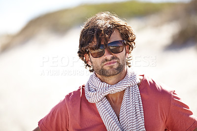 Buy stock photo A young man wearing glasses and a scarf looking directly at the camera