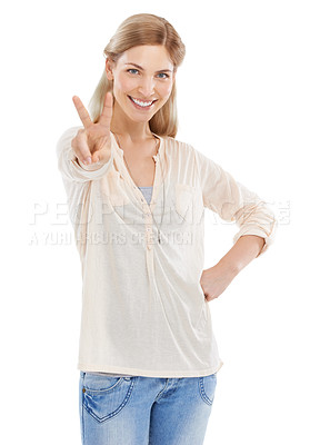 Buy stock photo Studio shot of an attractive young woman showing you the peace sign against a white background
