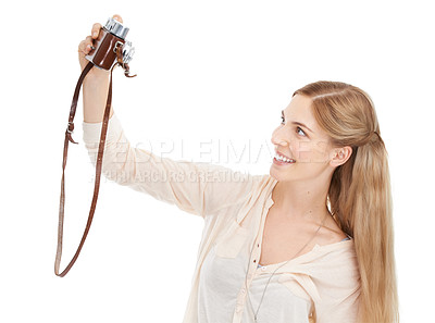 Buy stock photo Studio shot of a beautiful young woman  taking a selfie with her camera against a white background