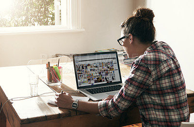 Buy stock photo Rearview shot of a young woman working from home