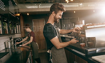 Buy stock photo Shot of a two young employees working in a coffee shop