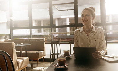 Buy stock photo Shot of a young woman looking thoughtful while sitting with her tablet at a cafe