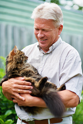Buy stock photo Cropped shot of a senior man with his cat outdoors