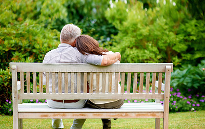 Buy stock photo Rearview shot of a couple on a bench outdoors