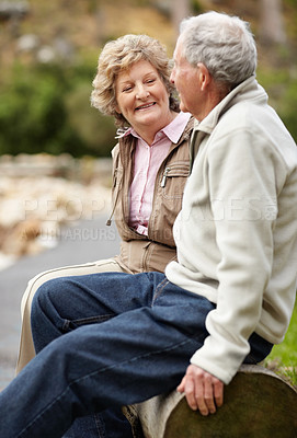 Buy stock photo Portrait of a happy mature couple sitting on log in countryside
