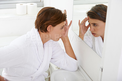 Buy stock photo Shot of a pregnant woman experiencing discomfort in the bathroom at home