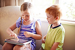 Using their tablet to play and learn
