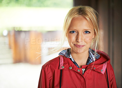 Buy stock photo Gorgeous young blonde woman wearing a red raincoat