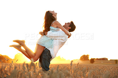 Buy stock photo Shot of an affectionate young couple enjoying a day in the sun