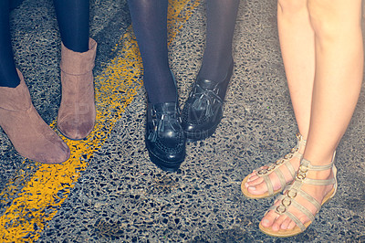 Buy stock photo Cropped shot of stylishly dressed people's feet on the sidewalk