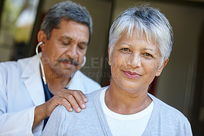 Buy stock photo Portrait of a senior woman getting a checkup from her doctor at home