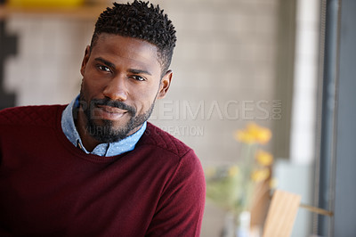 Buy stock photo A young african man sitting in a coffee shop