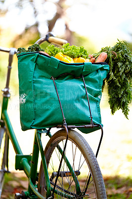 Buy stock photo Cropped shot of a bag of vegatables on a bike