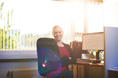 Buy stock photo Portrait of an attractive businesswoman sitting with her arms crossed in the office