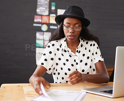 Buy stock photo Shot of a young woman working in her office