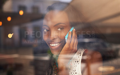 Buy stock photo Shot of an attractive young woman talking on a mobile phone in a cafe