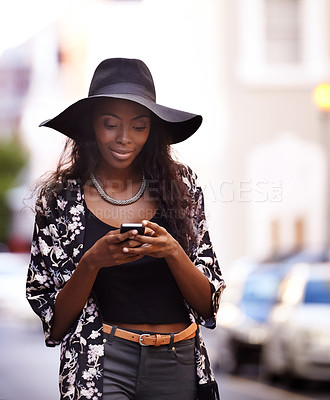Buy stock photo Shot of an attractive woman using her mobile phone in the city