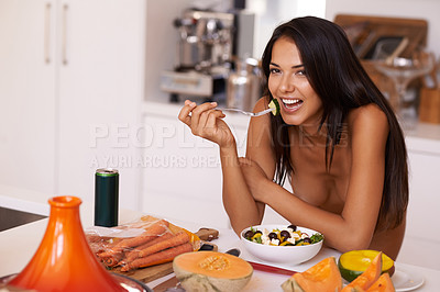 Buy stock photo Shot of a beautiful young naked woman eating in her kitchen