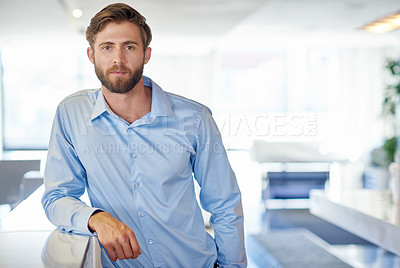 Buy stock photo Cropped portrait of a handsome young businessman in the office
