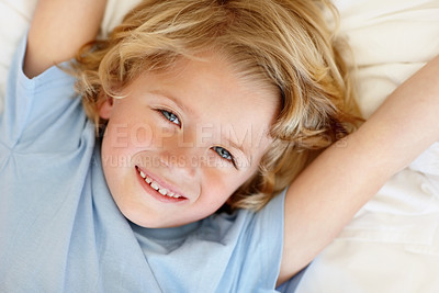 Buy stock photo Closeup portrait of an adorable kid  with lovely blond curls giving you a cute smile - copyspace