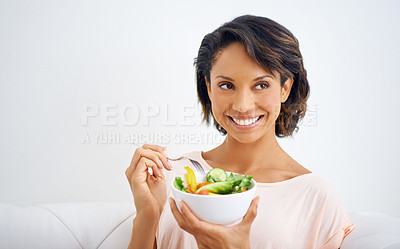 Buy stock photo Shot of a young woman enjoying a salad at home