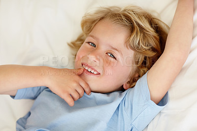 Buy stock photo Closeup portrait of an innocent boy giving you a cute smile
