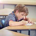 Concentrating on his classwork