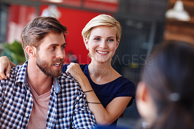 Buy stock photo Cropped shot of coworkers in an informal office setting