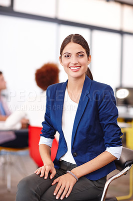 Buy stock photo Cropped portrait of an attractive young businesswoman sitting in her office