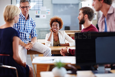Buy stock photo Cropped shot of a group of designers in their modern office
