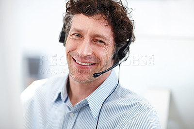 Buy stock photo Cropped portrait of a handsome call center operator in the office