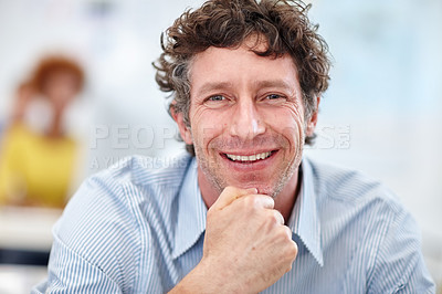Buy stock photo Cropped portrait of a handsome businessman sitting in the office