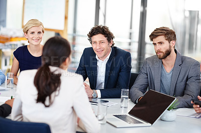 Buy stock photo Cropped shot of a group of designers having a meeting
