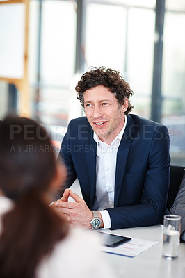 Buy stock photo Cropped shot of a businessman in a meeting with his colleagues