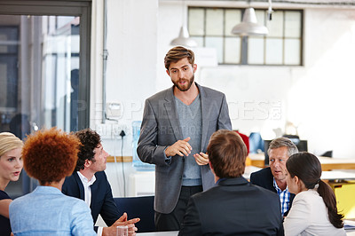 Buy stock photo Cropped shot of a group of business professionals in an office meeting