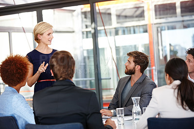 Buy stock photo Cropped shot of a female business professional sharing her ideas with her colleagues