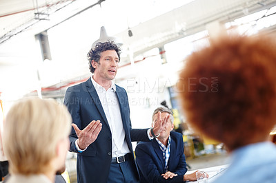 Buy stock photo Cropped shot of a businessman sharing his ideas with his colleagues