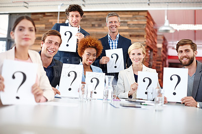 Buy stock photo Portrait of a group of businesspeople holding up cards with question marks on them