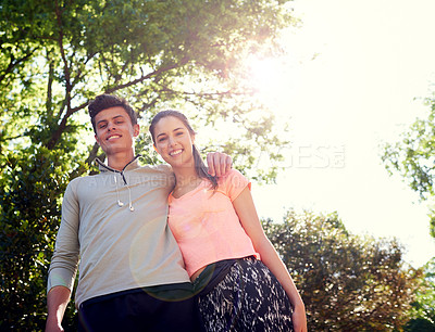 Buy stock photo Portrait of a sporty young couple walking together in nature