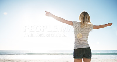 Buy stock photo Rearview shot of young woman on the beach