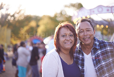 Buy stock photo Shot of a couple enjoying a day at a fair