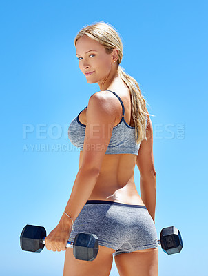 Buy stock photo Portrait of a smiling young woman lifting weights outside