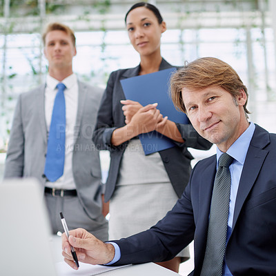 Buy stock photo Portrait of a group of serious business executives in a boardroom