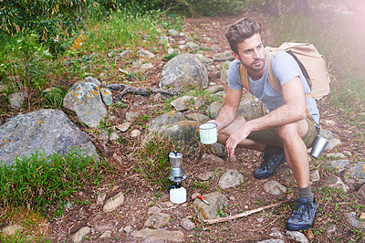 Buy stock photo Shot of a handsome hiker having coffee
