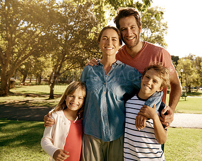 Buy stock photo Portrait of a family enjoying a day at the park together