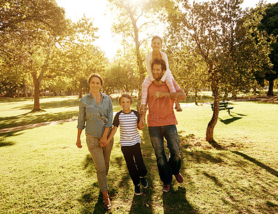 Buy stock photo Shot of a family of four spending time at the park