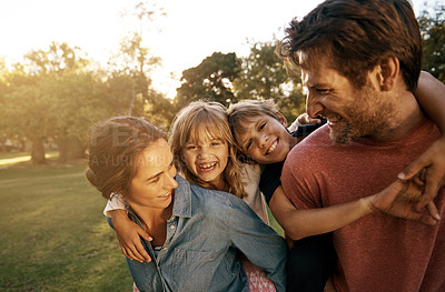 Buy stock photo Shot of a family with two children spending time together at a park