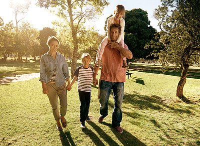 Buy stock photo Shot of a family enjoying a day at the park together