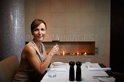 Buy stock photo Cropped shot of an attractive woman waiting for her date in a restaurant
