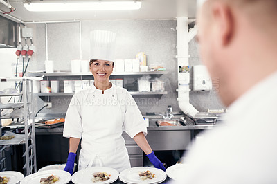 Buy stock photo Shot of chefs preparing a meal service in a professional kitchen